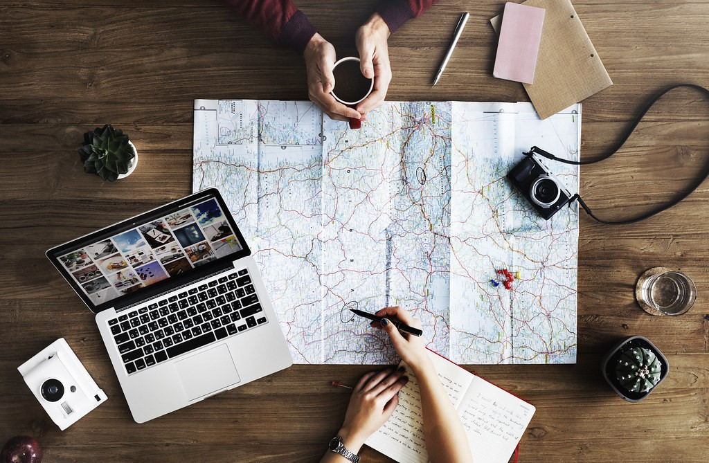 Delegate the travel planning responsibilities